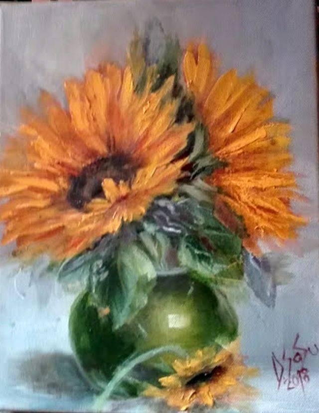 Poza Floarea soarelui in vas verde
