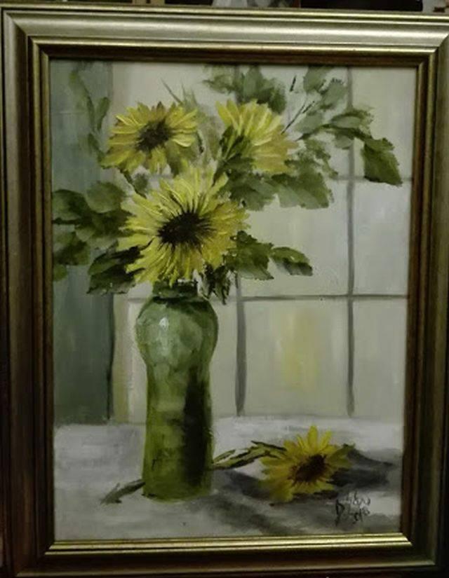 Poza Flori in fereastra