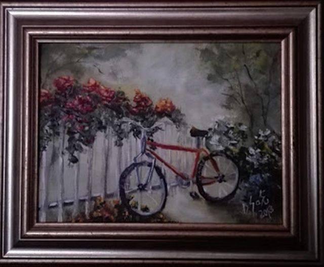 Poza O bicicleta intre flori
