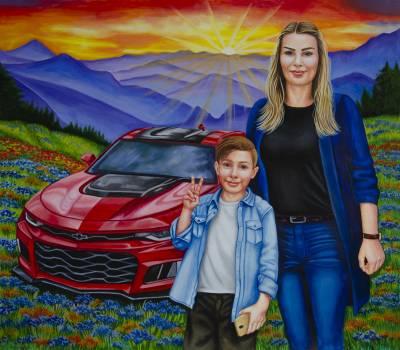 Poza Mama cu fiul lîngă mașina roșie