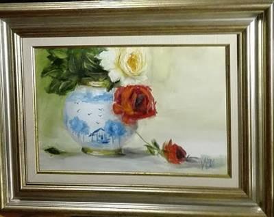 Poza Trandafiri in vas de portelan