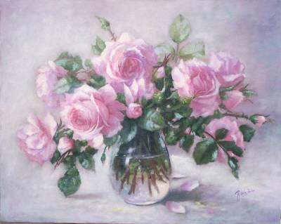 Poza Trandafiri roz in vas de sticla