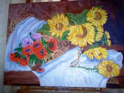 Picturi cu flori Cos cu floarea soarelui